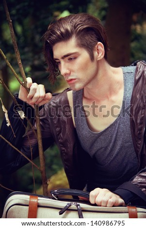 Young man travel around Japan - stock photo