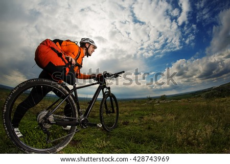 Young man travel by bicycle on rural road