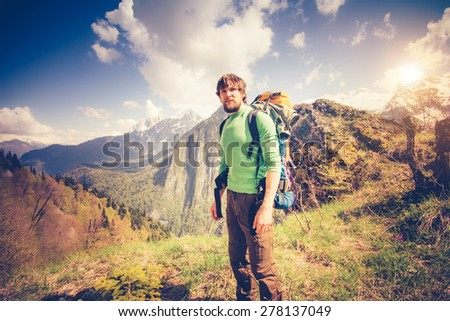 Young Man Traveler relaxing outdoor with mountains on background Summer vacations and Lifestyle hiking concept - stock photo