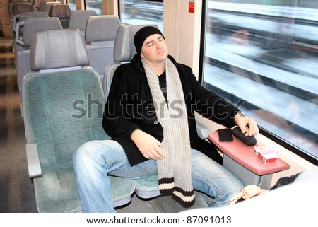 Young man traveling by train through Germany