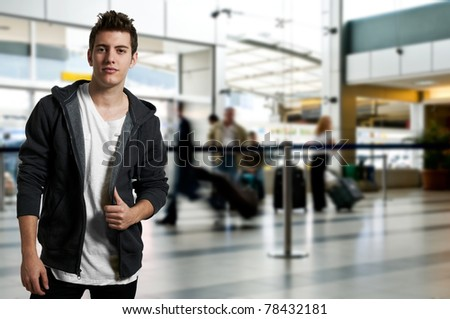 Young man traveling standing at the airport