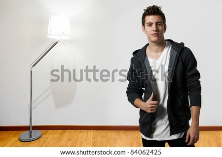 Young man traveling standing at the airport - stock photo