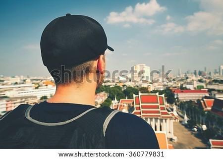 Young man traveling to Bangkok, Thailand - stock photo