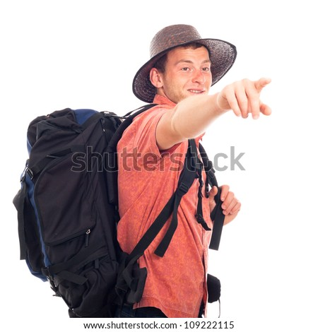 Young man traveling with backpack and pointing the way, isolated on white background with large copy space. - stock photo