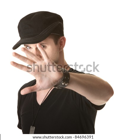 Young man tries to cover his face over white background - stock photo