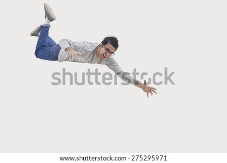 Young man trying to catch - stock photo