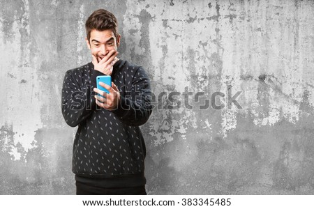 young man typing on mobile - stock photo