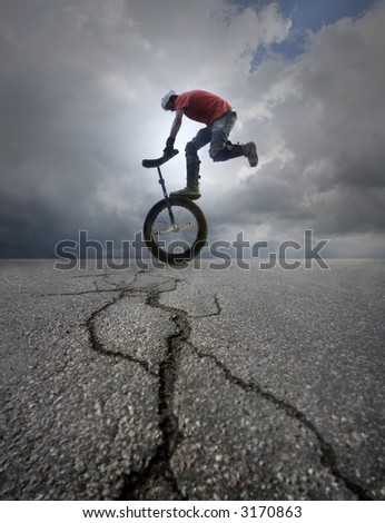 Young man unicycle on the street - stock photo