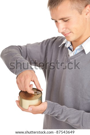 young man unlocks canned food, white background - stock photo