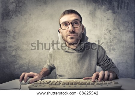 Young man using a computer - stock photo