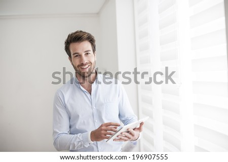 young man using a digital tablet - stock photo