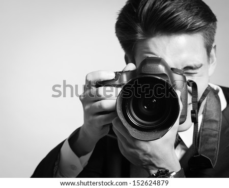 Young man using a professional camera