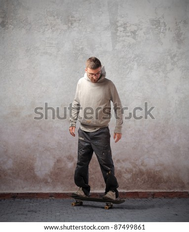 Young man using a skateboard - stock photo