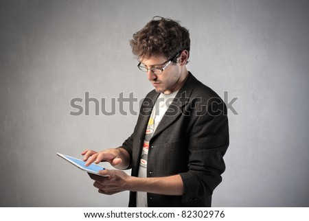 Young man using a tablet pc - stock photo