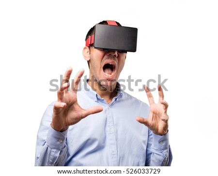 Young man using a virtual glasses against white background