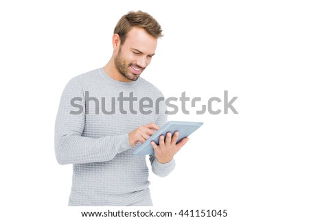Young man using digital tablet on white background - stock photo