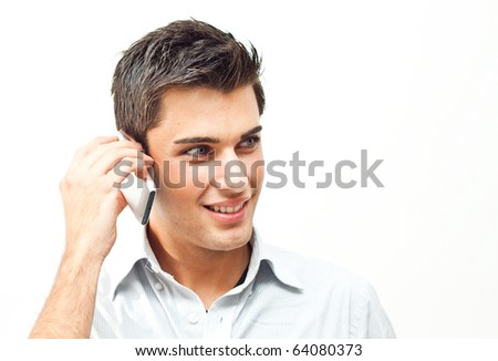 Young man using his mobile phone - stock photo