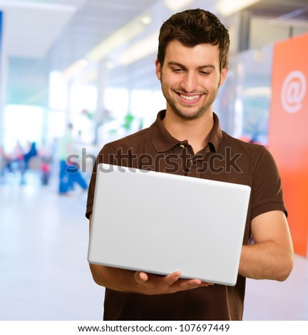 Young Man Using Laptop, Indoor - stock photo
