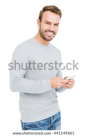 Young man using mobile phone on white background - stock photo
