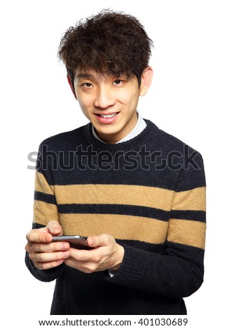 Young man using mobile phone SMS on white background