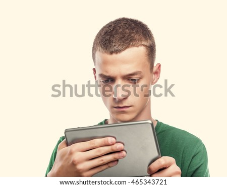 Young man using tablet computer against a white background. Toned photo.