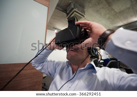 young man using virtual reality gadget computer technology glasses - stock photo