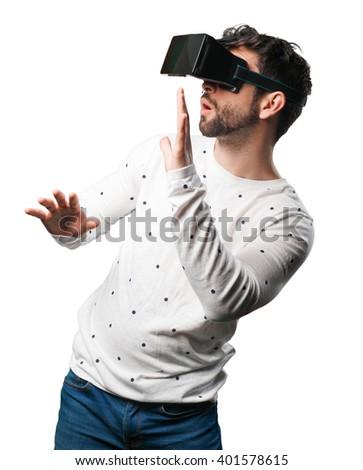young man using virtual reality glasses - stock photo