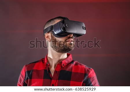 Young man using VR glasses headset