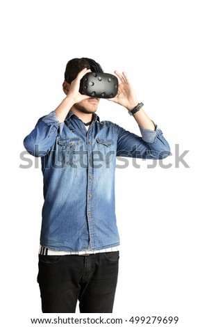 young man using VR virtual reality glasses headset