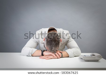 young man waiting for a call that doesn't come: studio portrait - stock photo