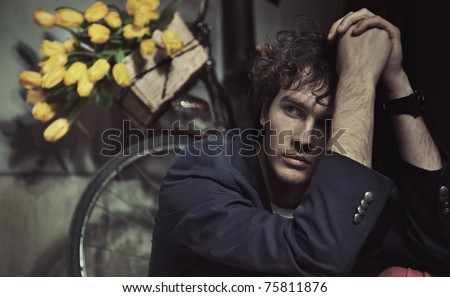 Young man waiting for a date - stock photo