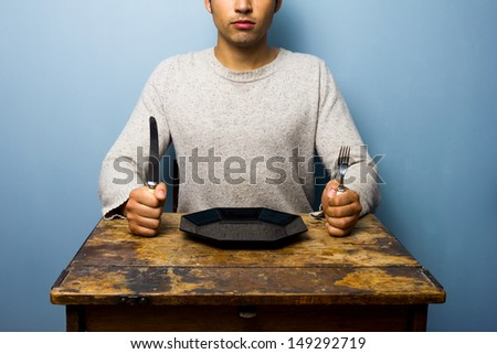 Young man waiting for his dinner - stock photo