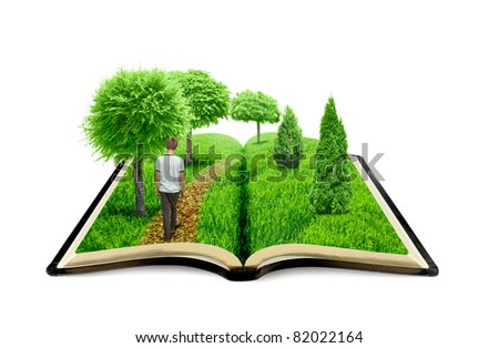 Young man walk on the book of nature - stock photo