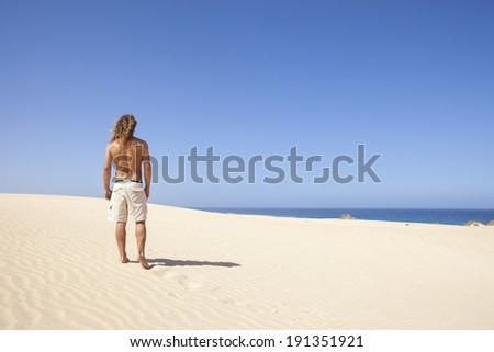 young man walking alone in the desert