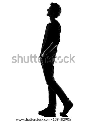 young man  walking  happy laughing silhouette in studio isolated on white background - stock photo