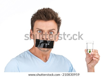 young man wants to stop drinking. closeup of man with alcohol and tape over mouth - stock photo