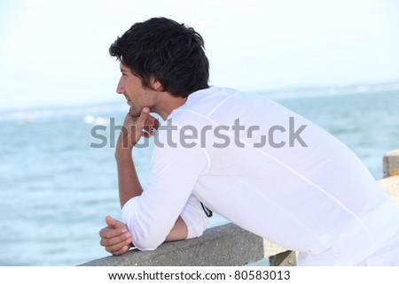 Young man watching horizon - stock photo