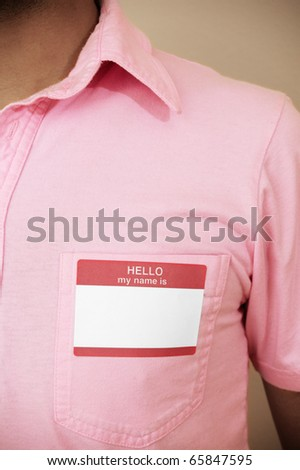 Young man wearing a blank name tag