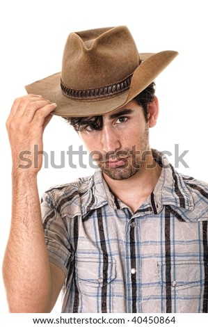 Young man wearing a cowboy hat isolated on white