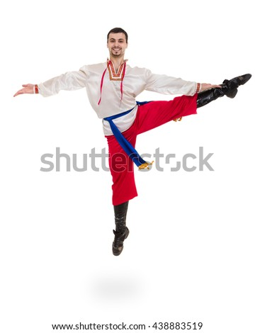 young man wearing a folk costume jumping against isolated white with copyspace - stock photo