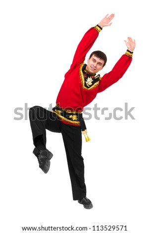 young man wearing a folk russian costume dancing against isolated white background - stock photo