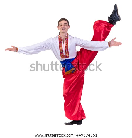 young man wearing a folk russian costume dancing against isolated white background with copyspace - stock photo