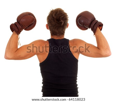 young man wearing a pair of boxing gloves - stock photo