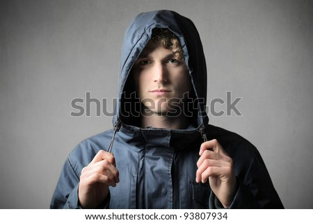 Young man wearing a windcheater - stock photo