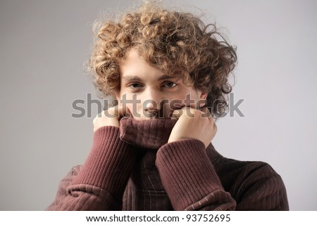 Young man wearing a wool pullover - stock photo