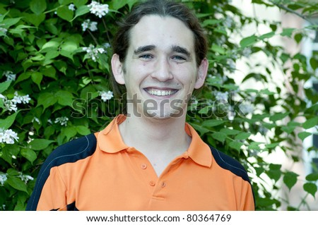 Young man wearing an orange t-shirt
