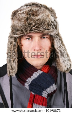 Young man wearing casual outfit and winter fur hat - stock photo
