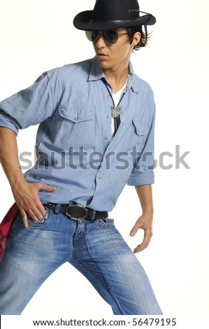 young man wearing cowboy posing - stock photo