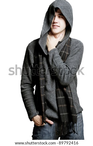 Young  man wearing gray sweater with hood. Isolated. - stock photo