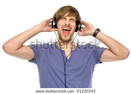 Young man wearing headphones - stock photo